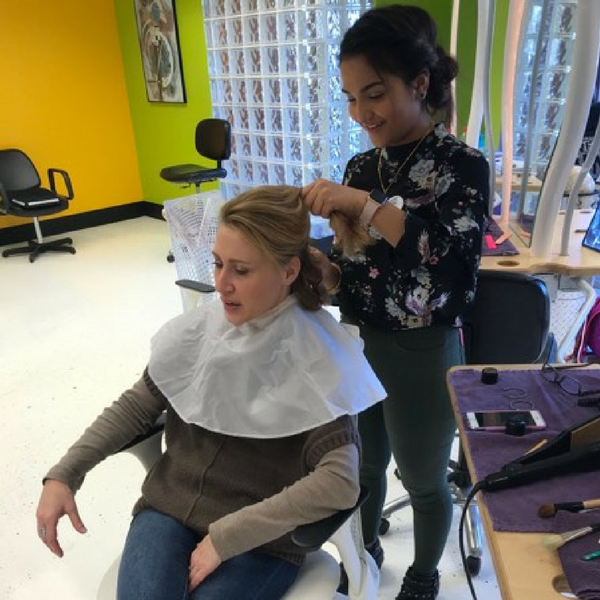 student performing hair services