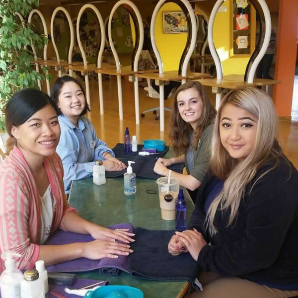 students performing manicures