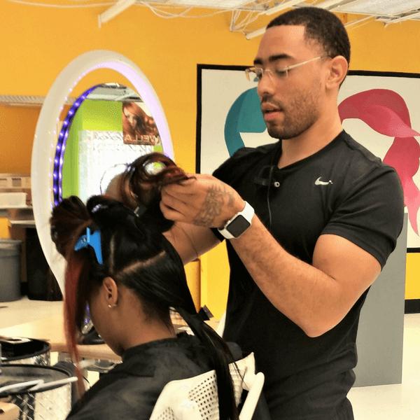 student cutting hair