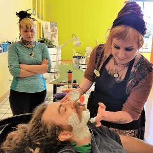 students performing shaving services