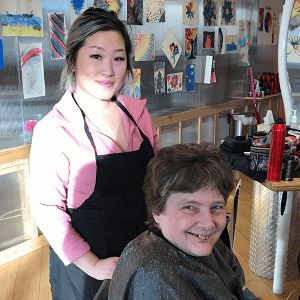 student and client after haircut