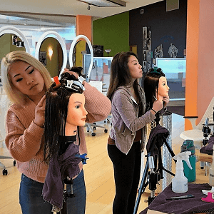 students practicing on manikins