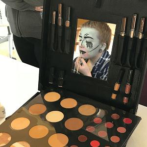 student applying makeup