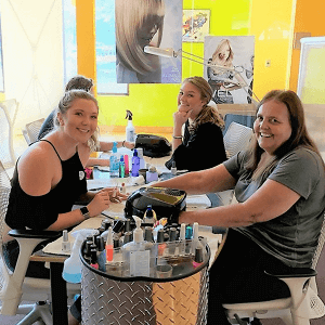 students practicing manicures