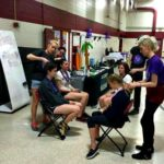 Cosmetology Students Volunteering