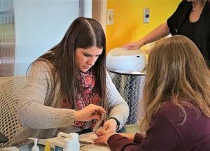 Instructor Teaching Manicures